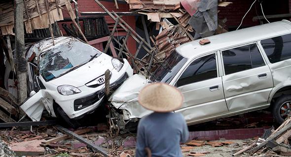 ההרס בעקבות פגיעת הצונאמי, צילום: אי פי איי