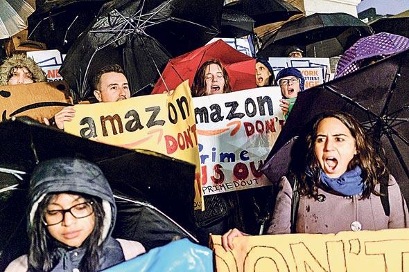 הפגנה נגד הקמת מטה אמזון החדש ברובע קווינס, צילום: בלומברג