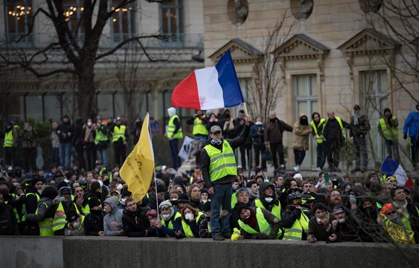 מחאת האפודים הצהובים, בסוף השבוע בפריז. אשליה של שיוויון, צילום: אי פי איי