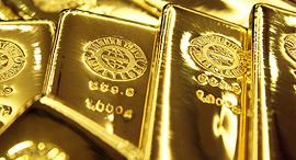 מטילי זהב הון כסף עושר, צילום: בלומברג