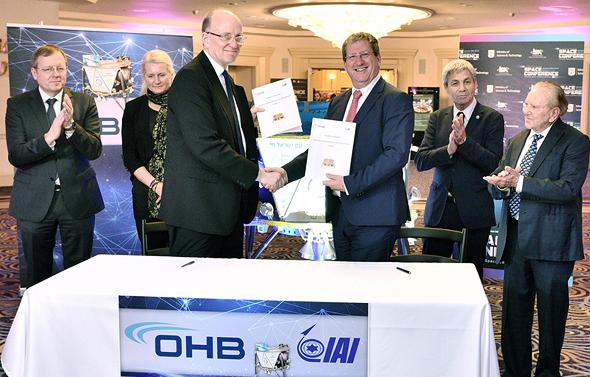 OHB and IAI representatives. Photo: Alex Polo