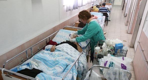 חולה במסדרון בית חולים (ארכיון)