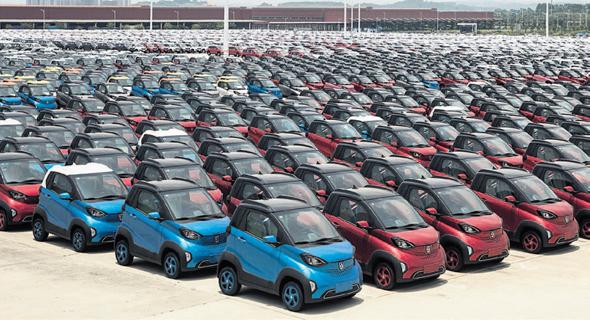 כלי רכב חשמליים יהיו הבסיס למיזם הרכב השיתופי החדש של עליבאבא וטנסנט, צילום: בלומברג