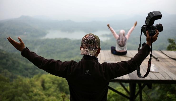 צלם צמוד בפארק האתגרים האינדונזי Kalibiru, צילום: בלומברג