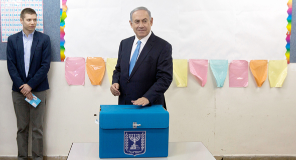 Israeli Prime Minister Benjamin Netanyahu voting in the 2015 election. Photo: Reuters