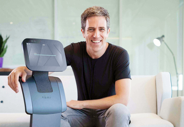 Yossi Wolf, founder and CEO of Temi, with the company's robot. Photo: Danny Isserles