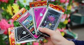 אייפון מנייר ששורפים בסין בחג צ'ינג מינג , צילום: Photo/CNS