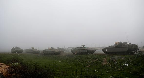 """כוחות צה""""ל סמוך לרצועה, צילום: אי פי איי"""