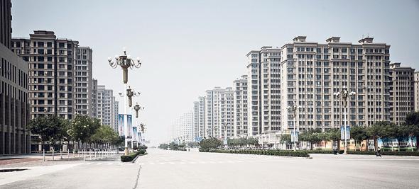 """פרברי טאנגשאן. """"ממשלות מקומיות שתלויות בהכנסות מנדל""""ן מכרו הרבה אדמות ליזמים"""", צילום: בלומברג"""