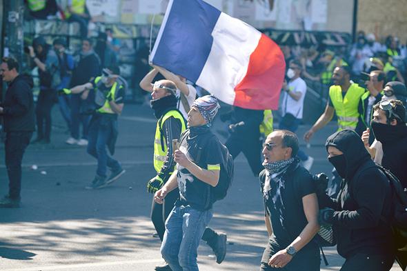 מחאת האפודים הצהובים בפריז, צילום: גטי אימג