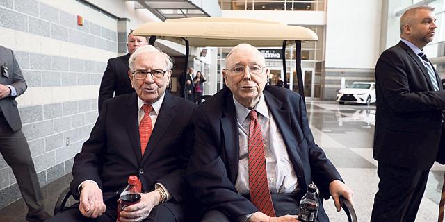 מימין: באפט ומאנגר, צילום: רויטרס