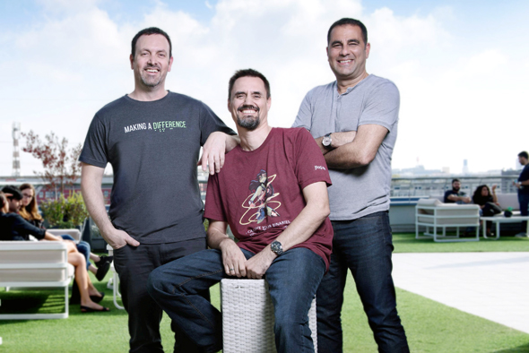 JFrog founders Yoav Landman (left), Frederic Simon, and Shlomi Ben Haim. Photo: Shachar Maor
