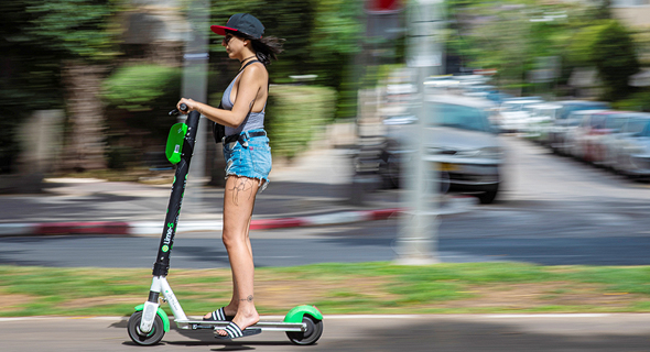 Lime e-scooter. Photo: Yuval Chen