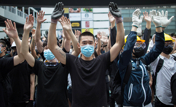 Protesters in Hong Kong covering their face to avoid facial recognition. Photo: EPA