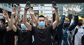 Protesters in Hong Kong covering their faces to avoid facial recognition. Photo: EPA