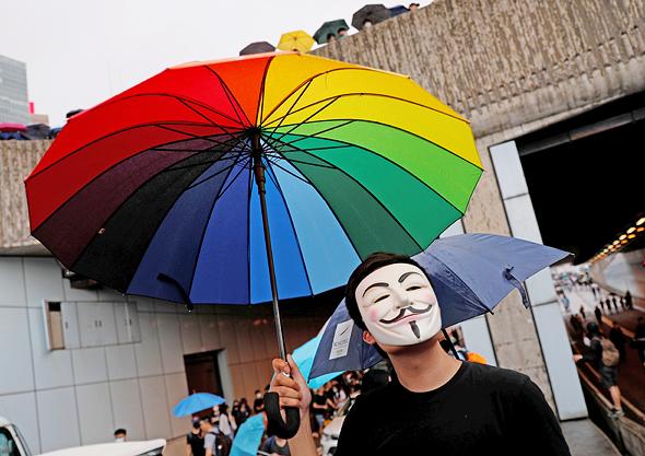 מפגינים בהונג קונג. האם המחאה תצליח לפגוע בכלכלה העולמית?, צילום: רויטרס