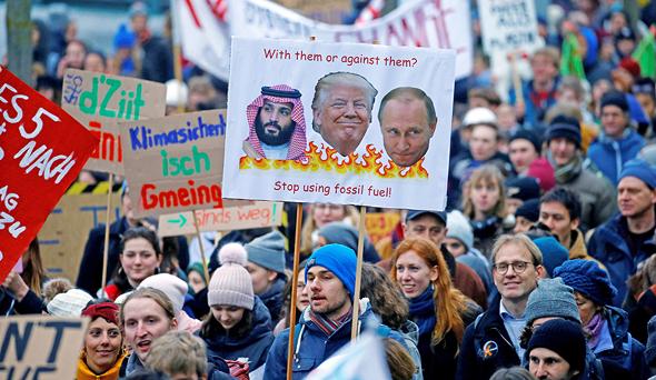 הפגנה בשווייץ למען הסכם אקלים גלובלי, צילום: רויטרס