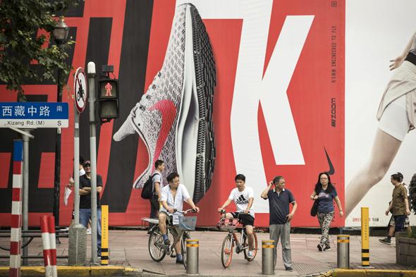פרסומת ל נייקי ב שנגחאי, צילום: בלומברג