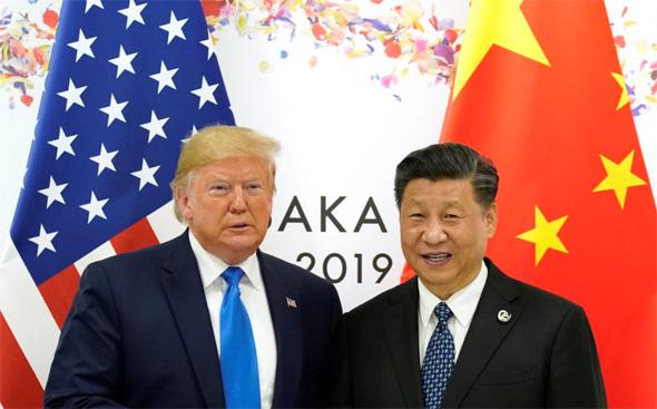 """נשיאי ארה""""ב וסין. לאחד מהם יש סיבה לחייך, צילום: רויטרס"""