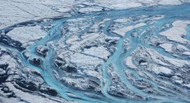 קרחונים נמסים בגרינלנד , צילום: WOODS HOLE OCEANOGRAPHIC INSTITUTION