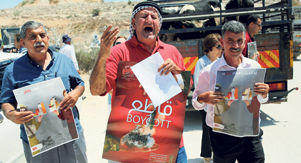 Palestinians demonstrating for the boycott of Israeli goods. Photo: AFP