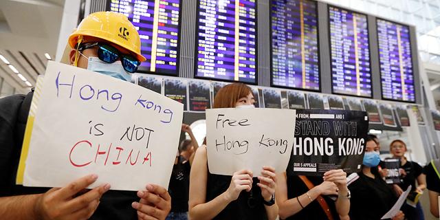 """בוטלו כל ההמראות, נעצרו כל הטיסות: המחאה השביתה את נמה""""ת של הונג קונג"""