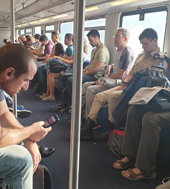 נוסעים ברכבת (ארכיון), צילום: רכבת ישראל
