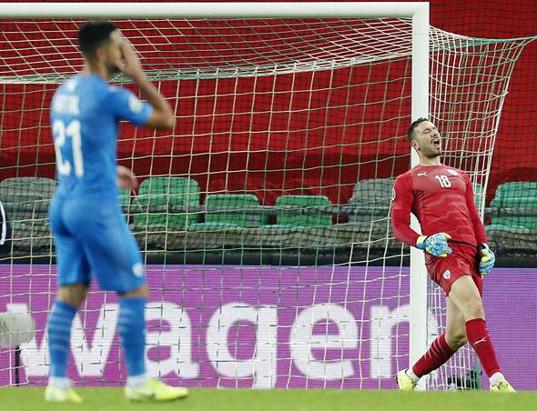 אופיר מרציאנו בירם כיאל. נבחרת ישראל מפסידה בחוץ לסלובניה יורו 2020, צילום: איי פי
