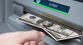 כספומט דולרים בנק משיכת מזומנים, צילום: Flickr, Tax Credits