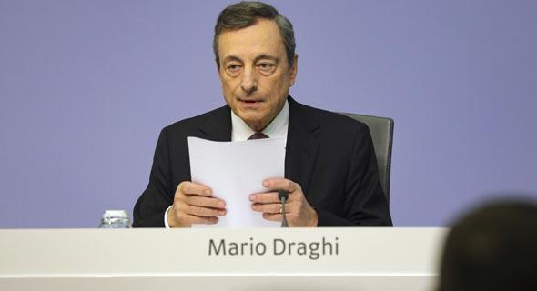 נגיד הבנק האירופי המרכזי מריו דראגי, לאחר ההודעה על הקלה כמותית, צילום: Bloomberg