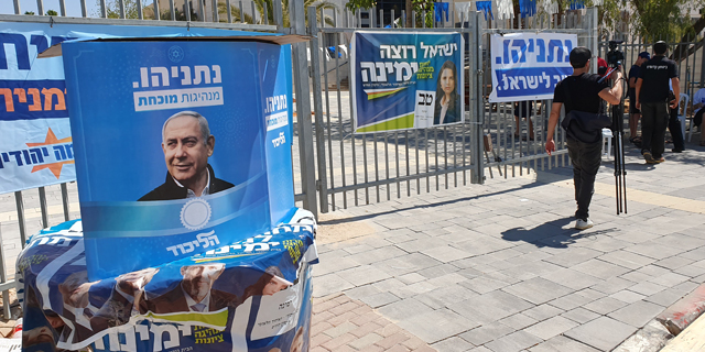 Ads for various right-wing parties outside a polling station in a Jewish settlement in the West Bank. Photo: Amir Kurz
