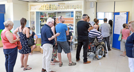 Voters waiting in line at a polling station on Tuesday. Photo: Dana Koppel