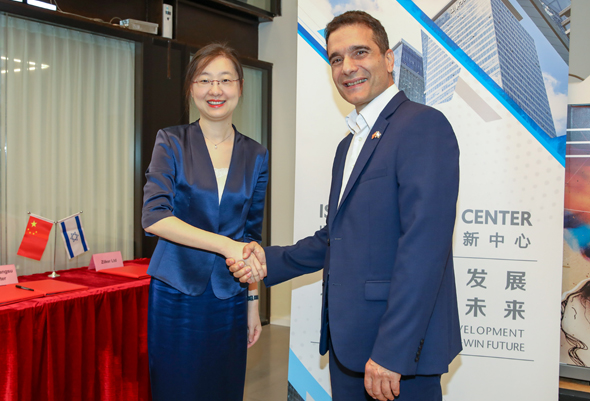 Photo: Li Lei, vice director of Wujin Hi-tech industrial zone, Changzhou (left) with Ilan Maimon, managing director of the center. Photo: Rami Levy