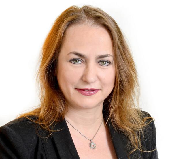 אלה רובינסקי, מנהלת מחלקת ניירות ערך בבינלאומי, קרדיט: תמר מצפי