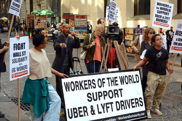 Uber and Lyft drivers protesting their working conditions. Photo: Shutterstock
