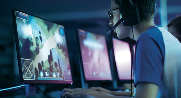 A gamer playing a videogame. Photo: Shutterstock