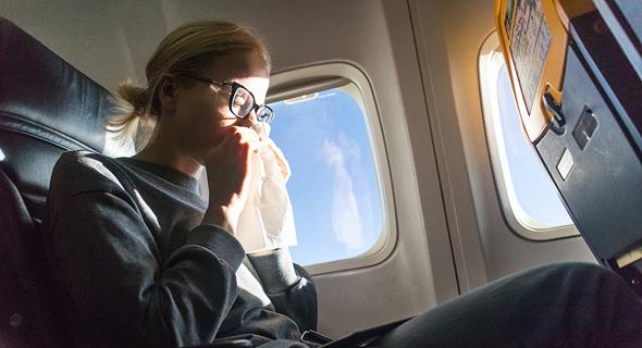 שפעת בטיסה, צילום: שאטרסטוק