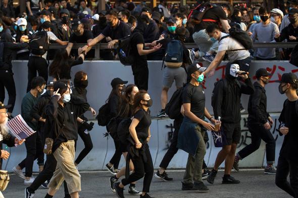 המחאה בהונג קונג בחודש דצמבר האחרון, צילום: גטי
