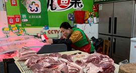 בשר חזיר. אטליז בבייג'ינג , צילום: רויטרס