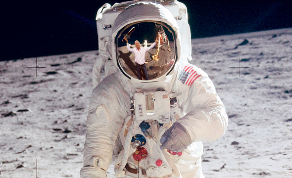 Richard Branson's reflections on an astronaut's helmet. Photo: Getty Images
