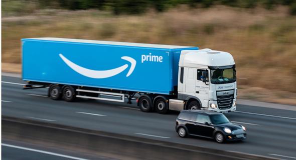 משאית משלוחים של אמזון. אין זמן להפסקות אוכל ושירותים, צילום: שאטרסטוק