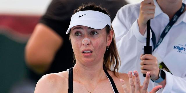 באוסטרליה מתעקשים לשחק טניס - ונחנקים מעשן השריפות המשתוללות