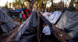 פליטים בגבול מקסיקו, צילום: איי אף פי