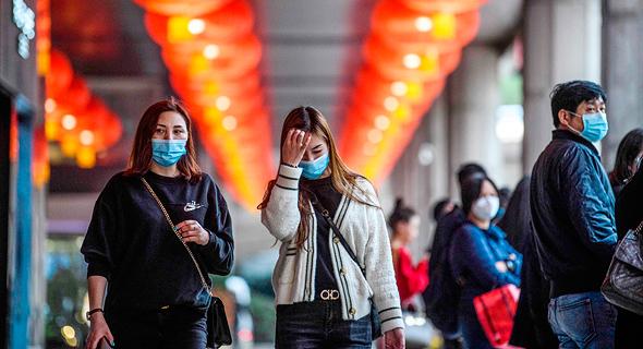 אנשים עם מסכות נגד הידבקות בסין, צילום: איי אף פי