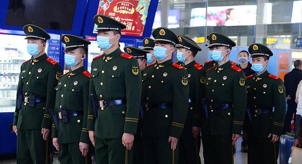 מתגוננים מפני הווירוס בסין