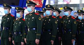 מתגוננים מהווירוס בסין, צילום: איי פי