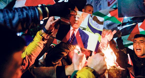 מחאה ברמאללה נגד תוכנית המאה, צילום: AHMAD GHARABLI