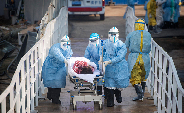A coronavirus patient is taken to hospital. Photo: AP