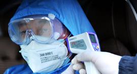 נגיף וירוס קורונה סין מדידת חום בדיקה, צילום: אי פי איי