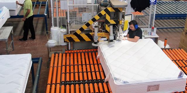 Workers at a matress factory. Photo: Kobi Fuda
